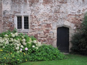 Wooden doorway and window in a stone wall