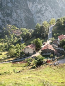 Steep road seen from above snakes through Spanish mountainside village