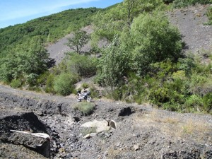 Bike is prevented from continuing along a narrow track of shale by a small landslide