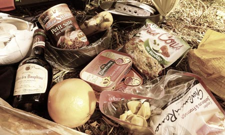 An assortment of tinned delights including pasta, lentils, pork and of course wine