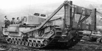 Black and white photo of a tank with some kind of frame strapped to the front