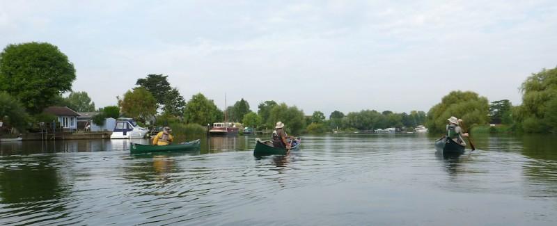 Three canoes brave the turbulent Thames near Laleham