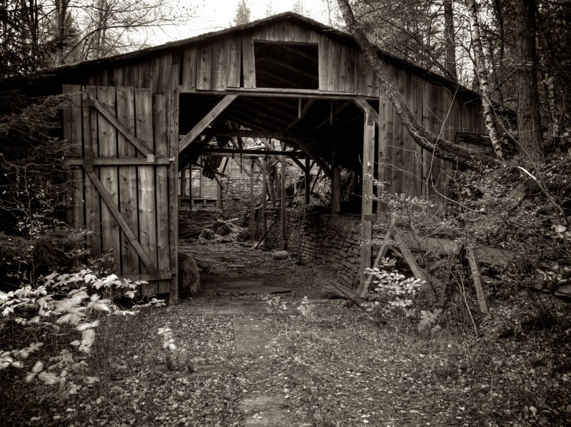 Black and white picture of a large barn