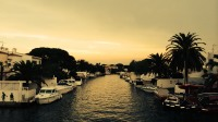 A cheap golden filter effect attempts to cheer an otherwise unremarkable sunset over a canal in Spain.