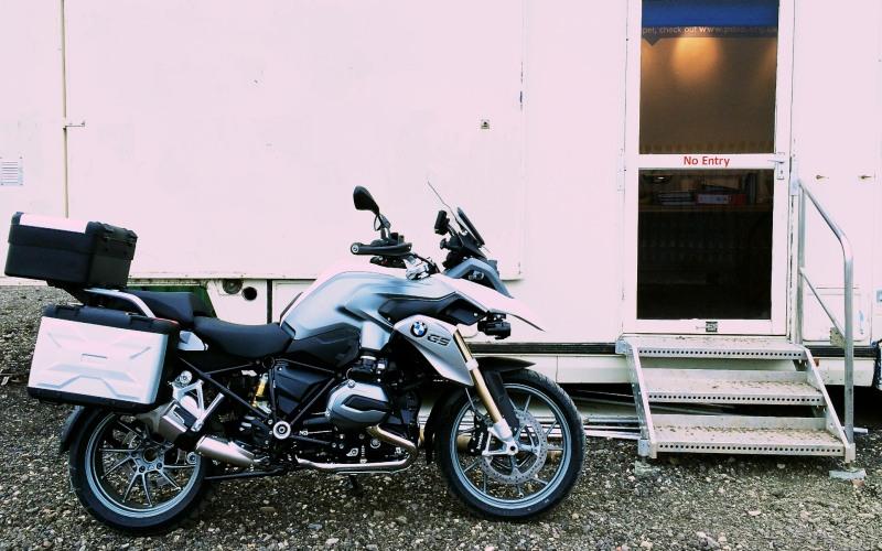 New shiny BMW Motorrad outside a portacabin