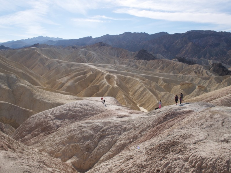 A family climbs on the rock formations at Zabriskie Point