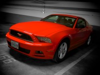 A red Mustang lurks in a hotel garage