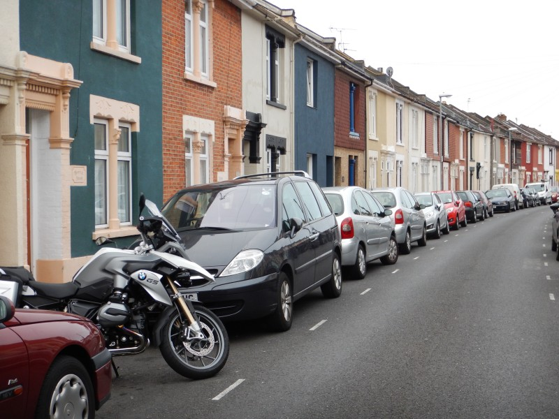 Bike parked among cars in front of terraced houses, Portsmouth