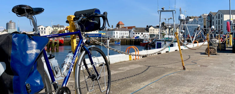 Ridgeback Panorama touring bike parked next to Ramsey harbour