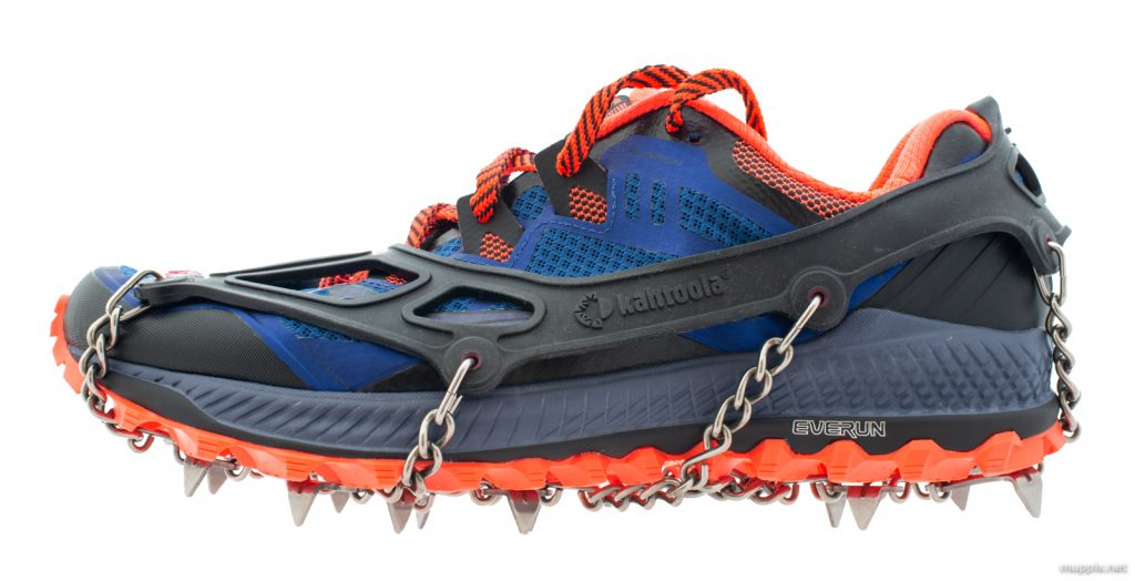 Product shot of a Saucony Peregrine running shoe fitted with Kahtoola Microspikes