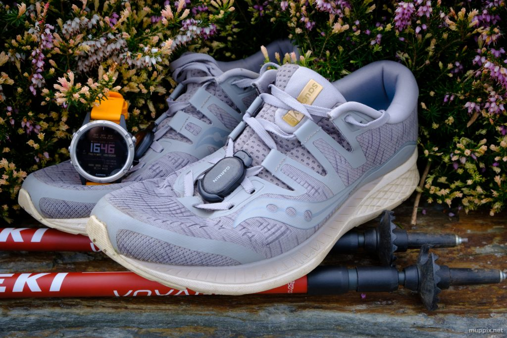 A pair of Saucony Ride ISO shoes with Garmin Foot Pod, Fenix 5+, and Leki Voyager hiking poles