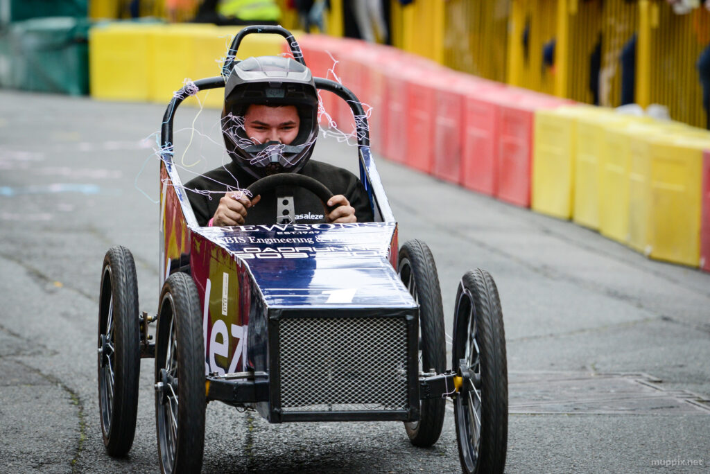 Action photo of a soapbox cart going down the hill