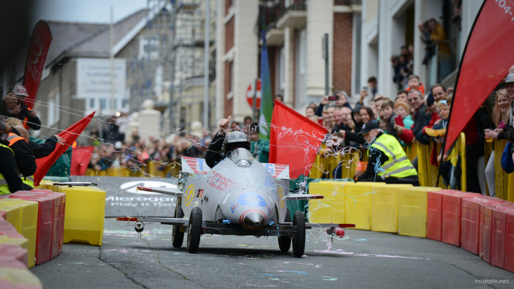 Action photo of a fighter jet soapbox cart going down the hill